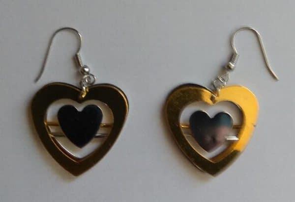 Boucle d'oreille métal 2 coeurs